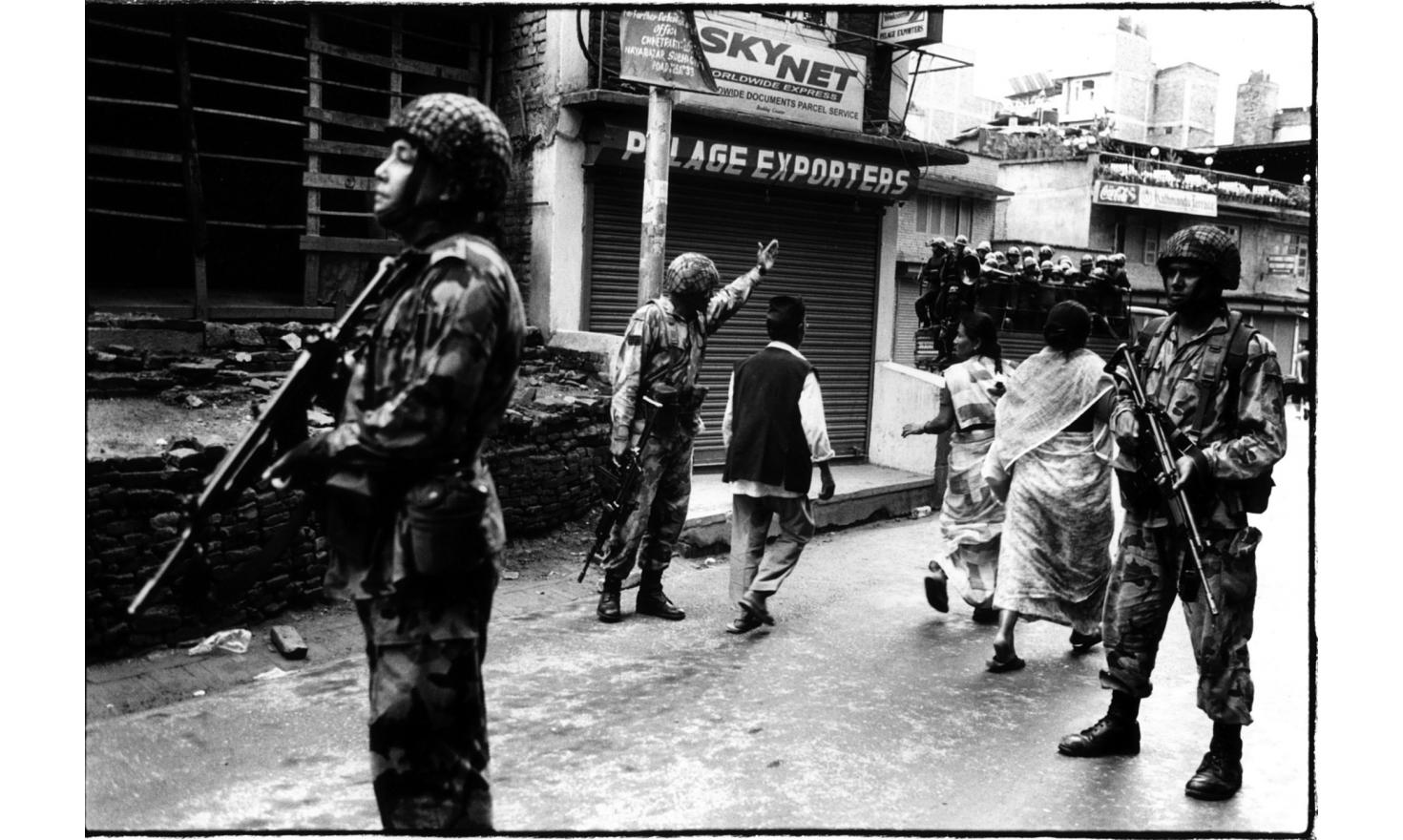 Ghurkas soldiers are in charge of the streets security, since curfew has been declared the days following the royal tragedy, Kathmandu June 2001