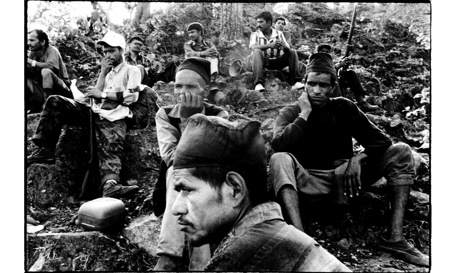 Walking with the Maoists, on the way to Dunge Schwar village, Nepal, 24th of May 2001, meeting hill people. No talk, no communication, an austere atmosphere… Smoking the traditionnal pipe of charasse is not allowed by the Maoists, neither are cigarettes,