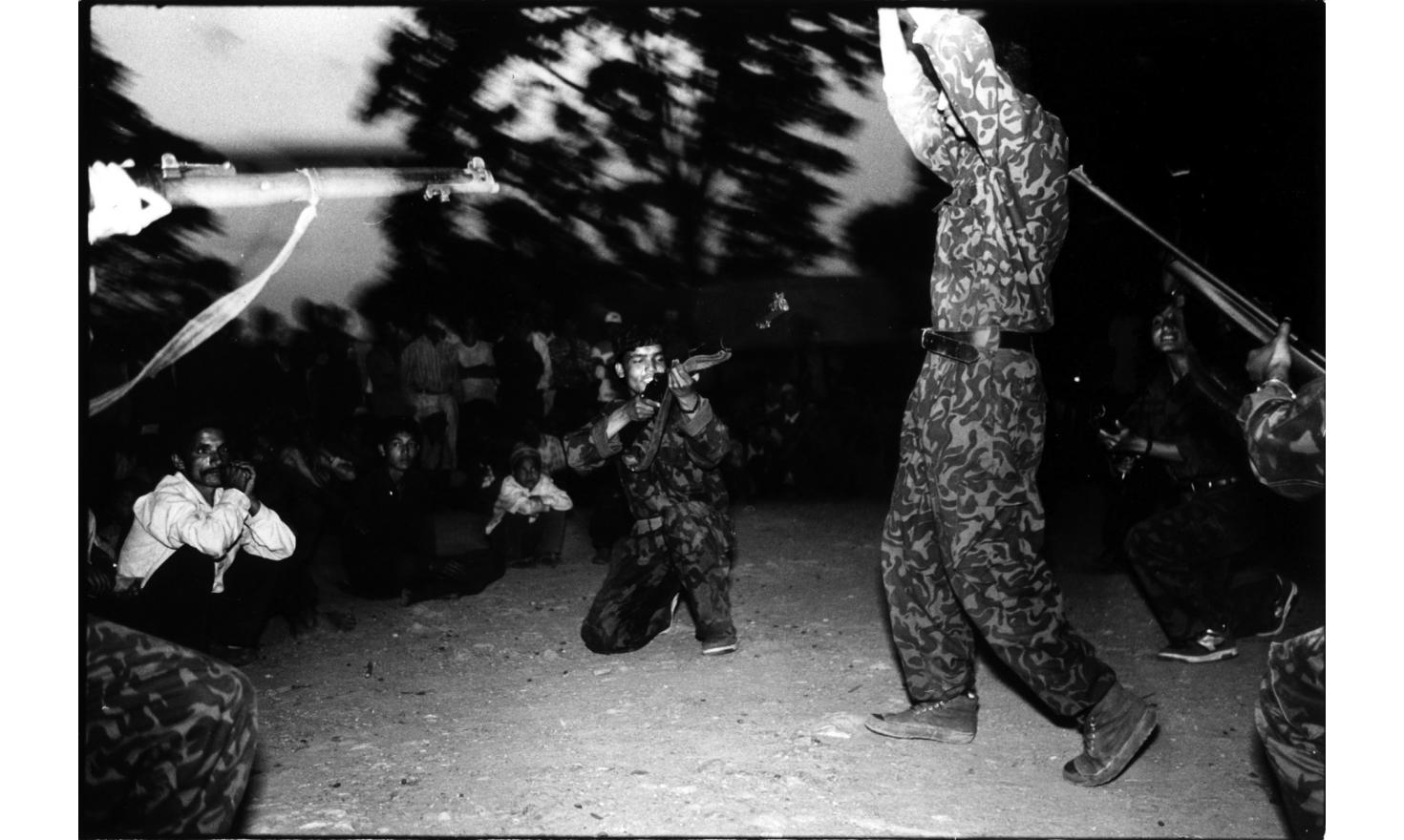 The Maoist cultural team entertains the assembly of villagers with revolutionary songs and dances in between speeches for the local Maoist government election, Malika village, 25th of may 2001
