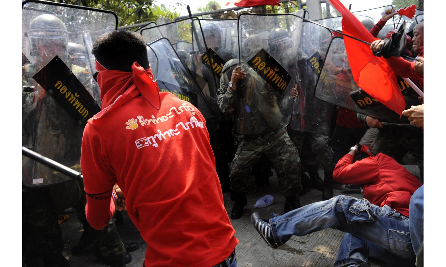 Red Shirts push the Army to enter the ThaiCom compound in PathumThani, Thailand