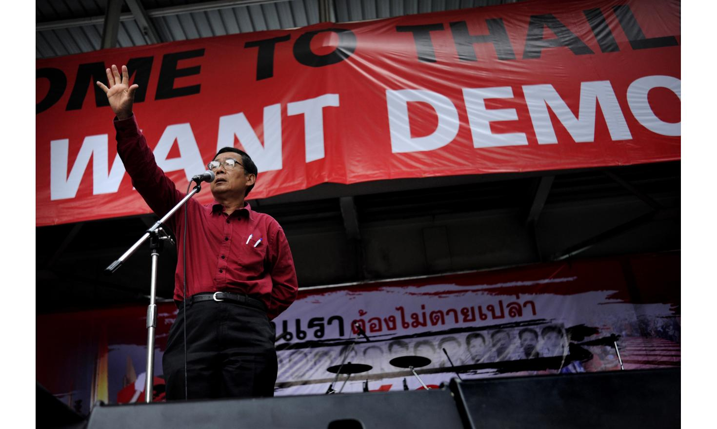 Doctor Weng one of the Red Leaders speaks to his crowd in Rajpasong intersection, occupied by the reds for over a month now, Center of Bangkok Thailand