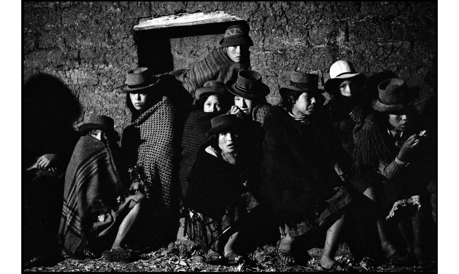 night meeting of campesinos,  in the town house of a village in the Ancahuasi region in the Peruvian Andes. Peru. October 25, 1982