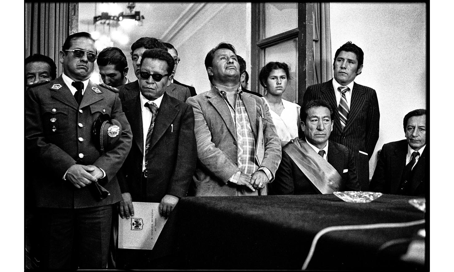 Officials listening to the newly elected president of Bolivia, Hernan Slies Zuazo, for his first visit as president. Potosi, Bolivia. November 10, 1982