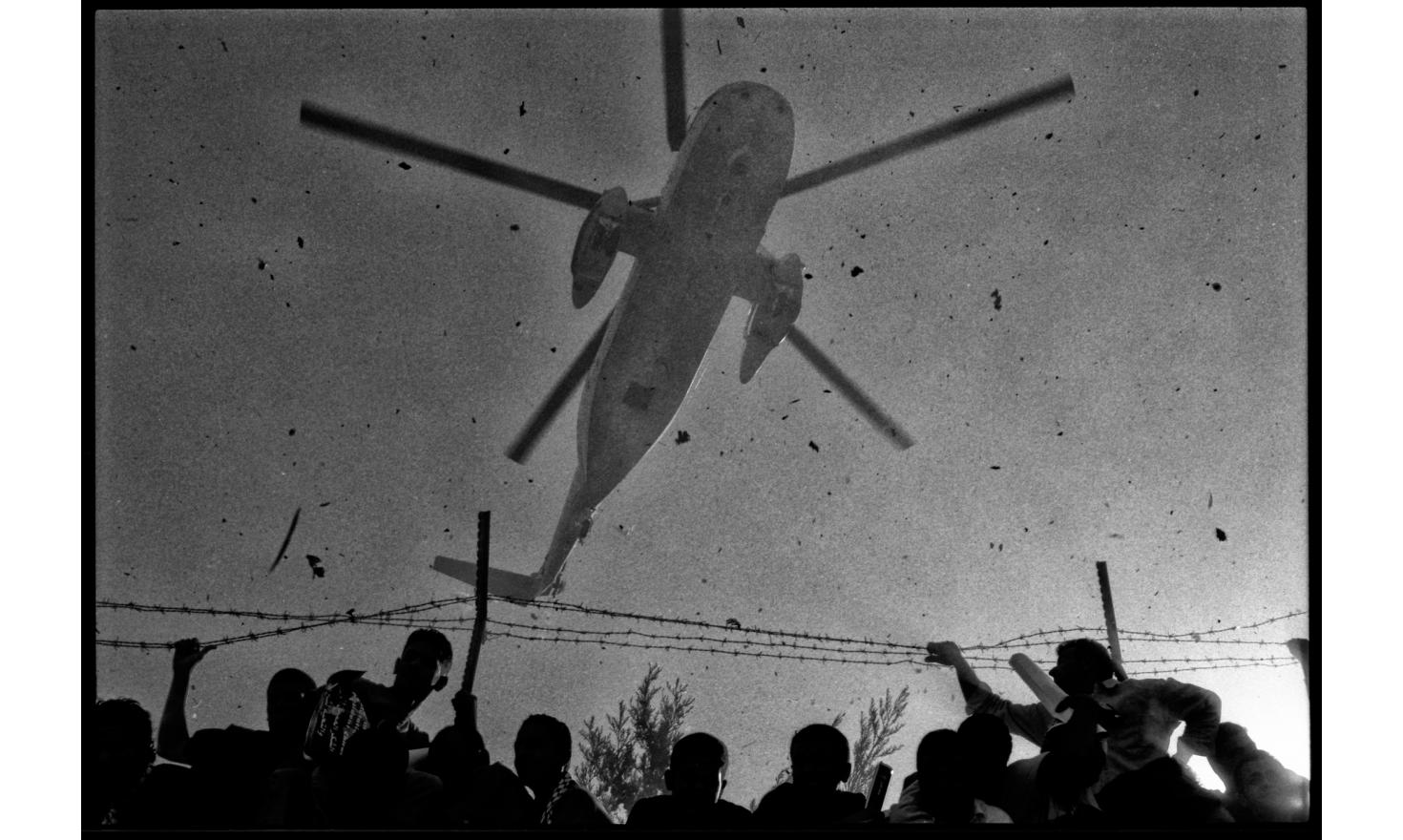 Helicopter bringing the remains of Yasser Arafat. Ramallah, Occupied West bank. November 2004.