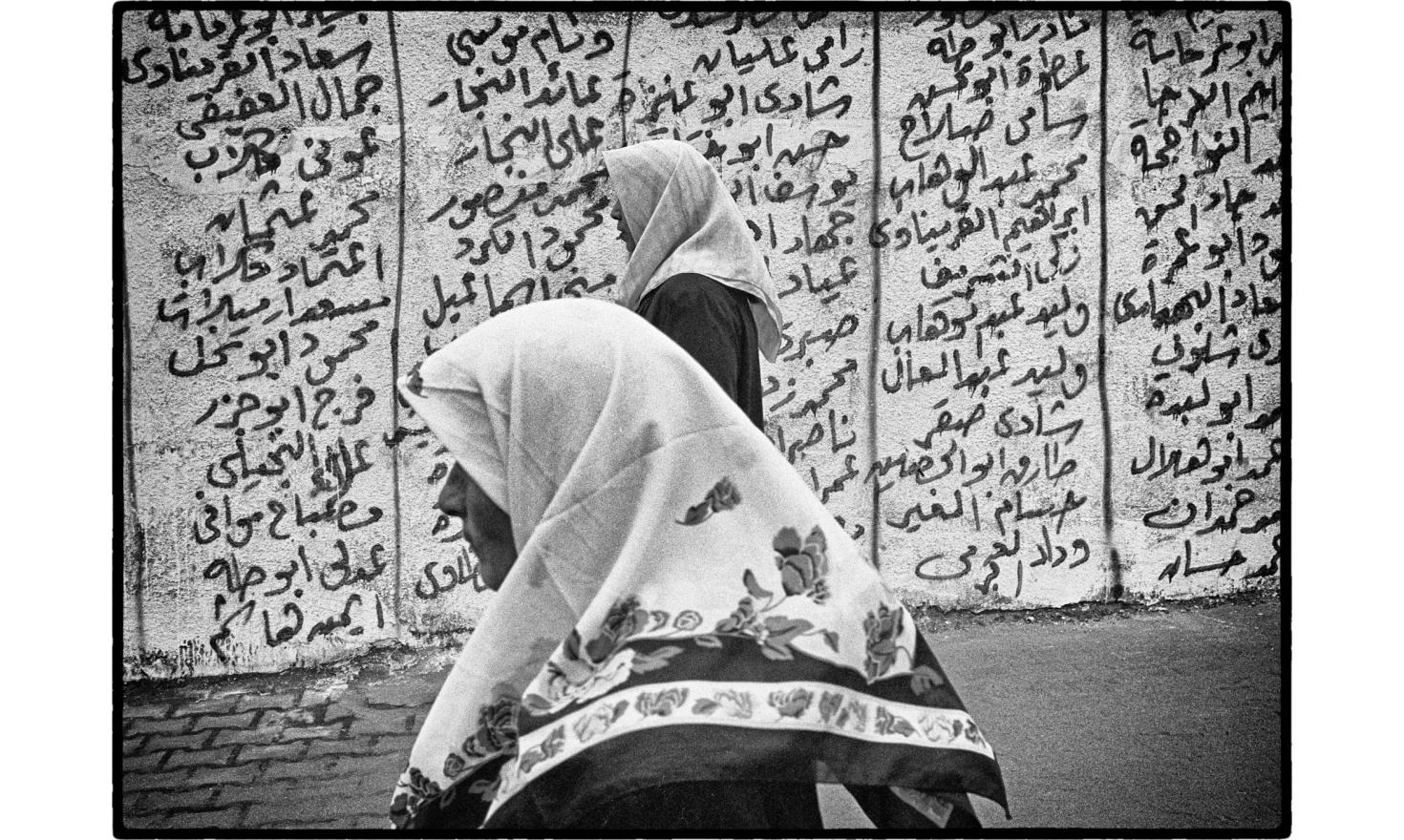"A wall is covered with the names of the""martyrs"". Rafah, Occupied gaza strip. November 2004."
