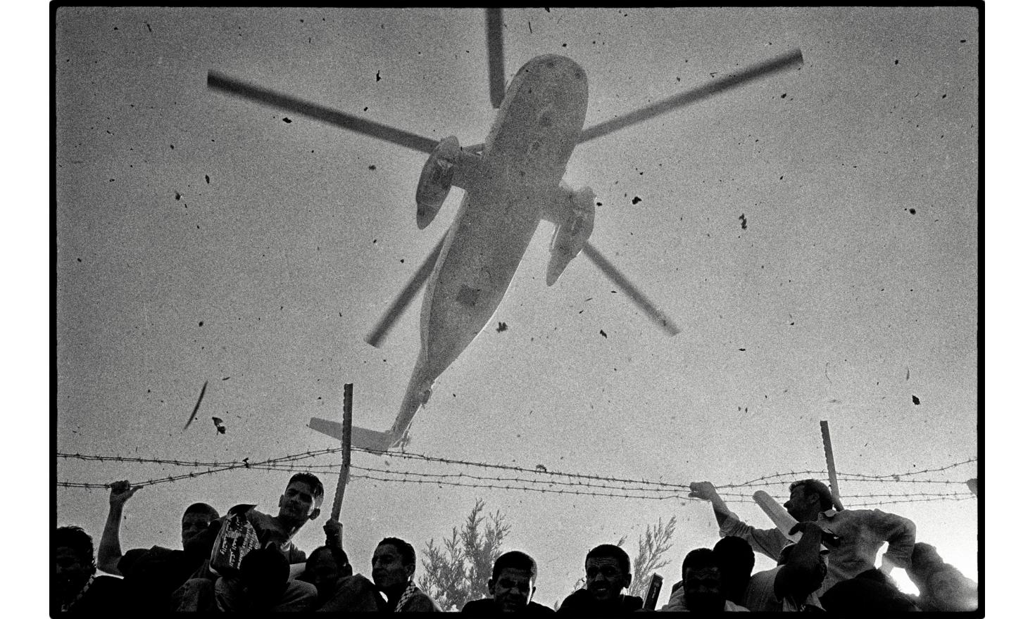 "The helicopter bringing the Arafat's coffin landed at the ""Muquata"" headquarters. An important page in the history of the Palestinian has finished. Ramallah, Palestinian Authority. West bank. November 2004."