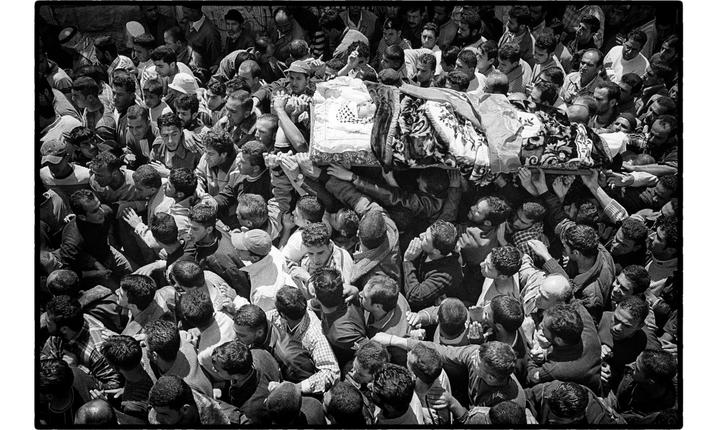 Funerals of a young Palestinian killed during a demonstration against the construction of the security barrier. Biddu, West bank. April 2004.