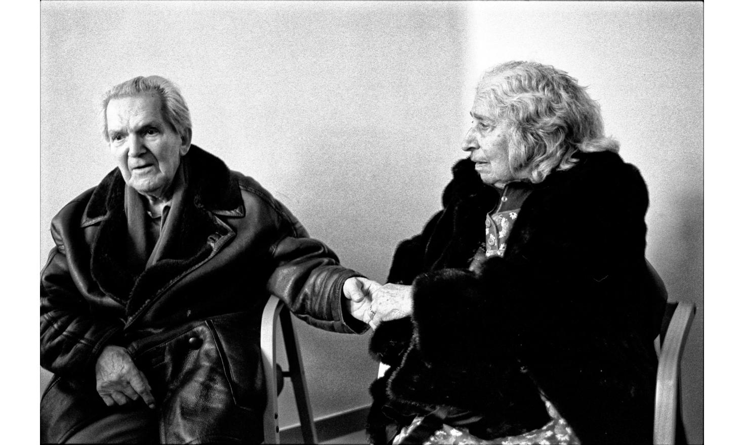 My father is very tired. I try to convince him to put my mother in a nursing home. During the interview with a doctor, my mother seems to realize that something serious is going on. She takes his hand. Paris february 2003.