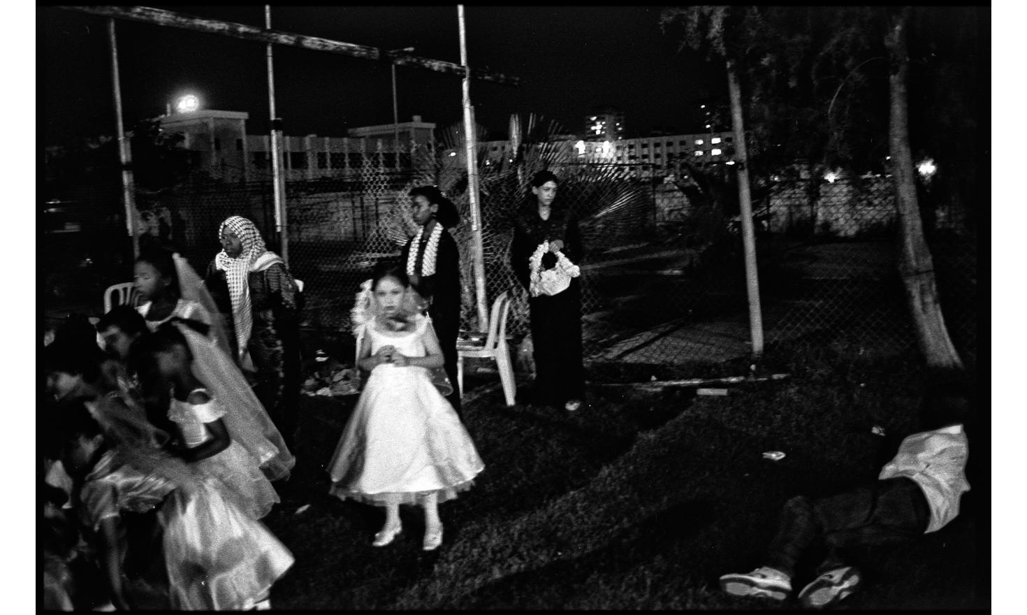 A group wedding has been organized by Hamas in a Gaza stadium. Husbands are introduced to the audience. The wifes, not present in the stadium, are represented by ten virgin girls, around 10 years old. Gaza, september 2005.