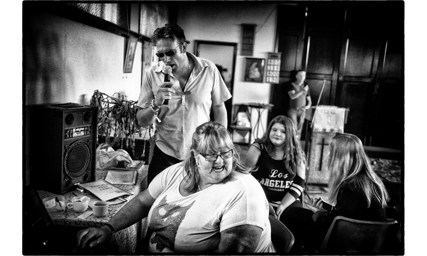 "In Jaywick, there is a man, Danny Slogett who started the""Jaywick Happy Club"", where people meet, sing and exchange about the town and their lives . Clacton on sea, England. July 2016."