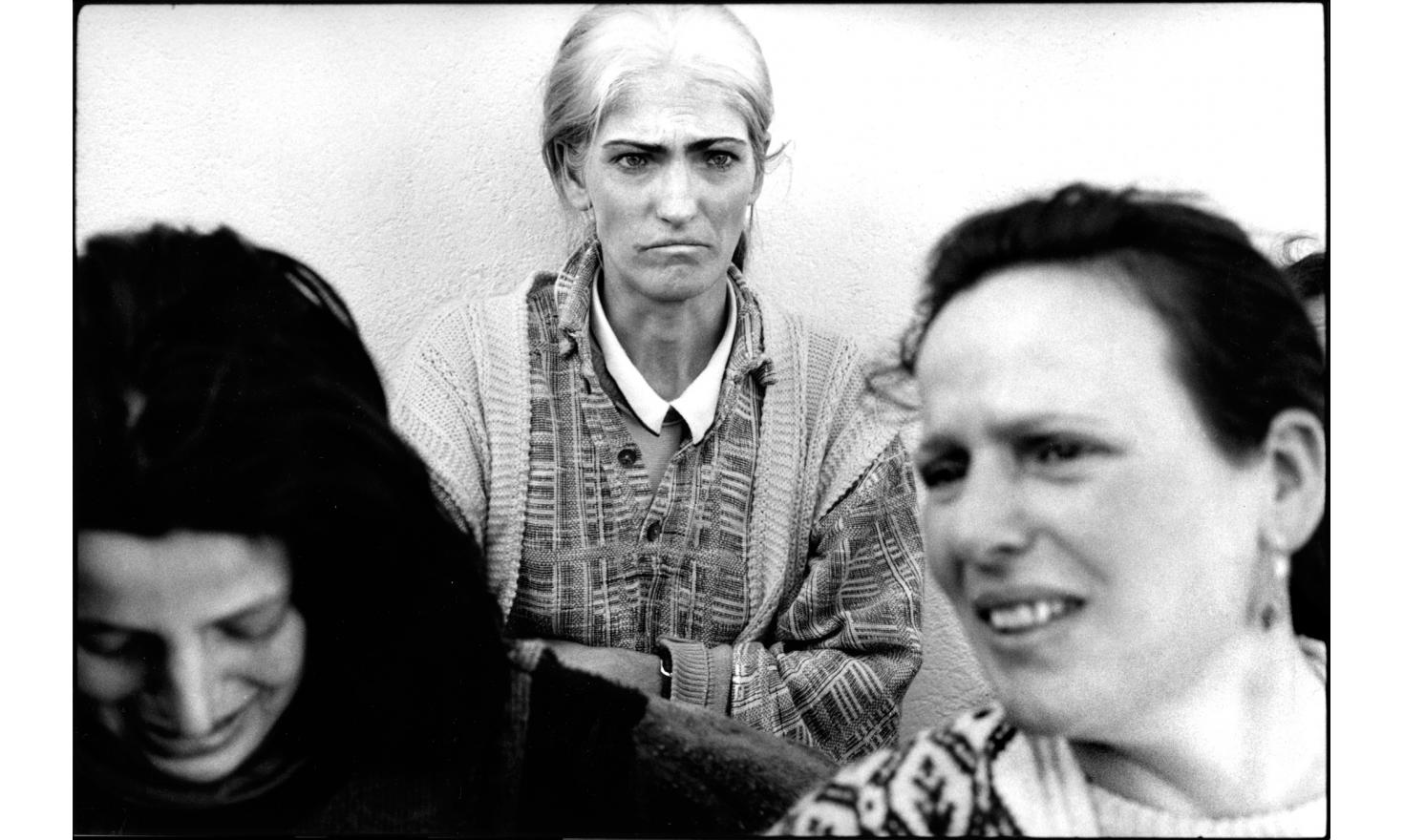 Albanian women from Prekaz, Kosovo. They found shelter in a neighboring village after the attack of the serbian special forces that left 52 dead among the villagers. Kosovo, Serbia. 03-1998.