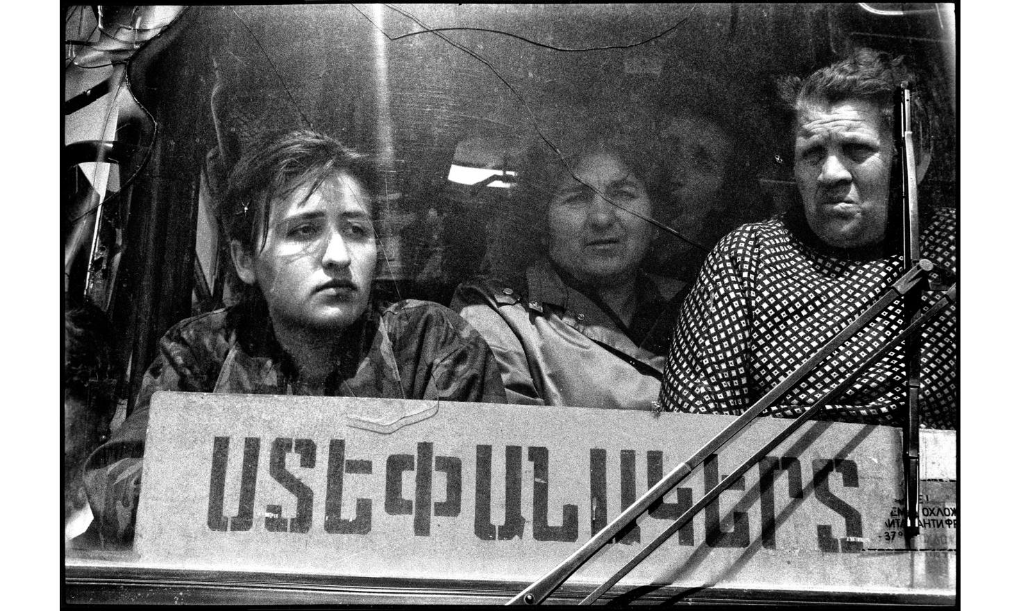Women leaving one of the graveyard of Stepanakert. Dozen of dead are brought everyday  from the war zone. Stepankert, Nagorny Karabakh. 04-1994