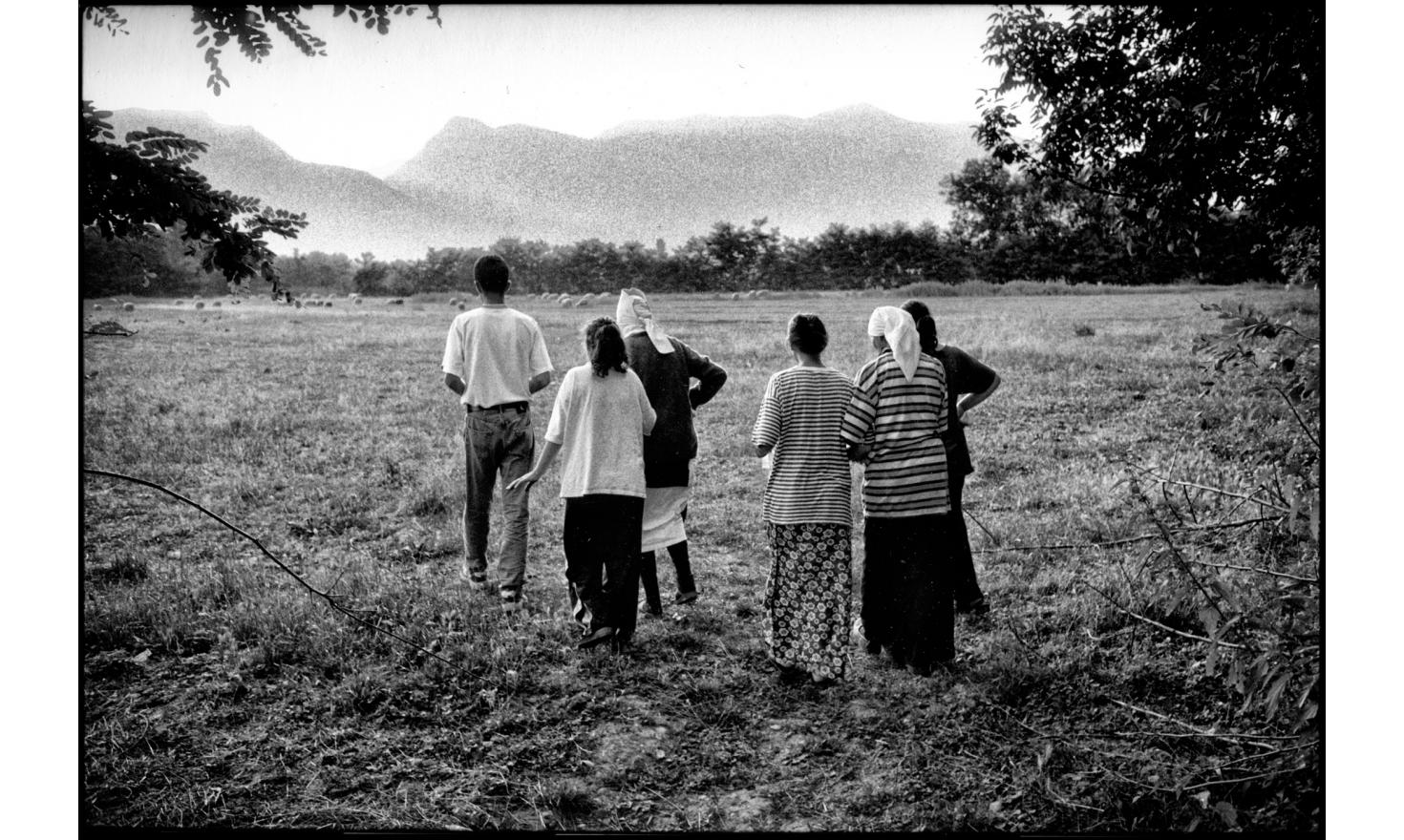 Villagers after they paid  homage on the scene of a massacre by Serbian forces.Quishk, Kosovo. 07-1999