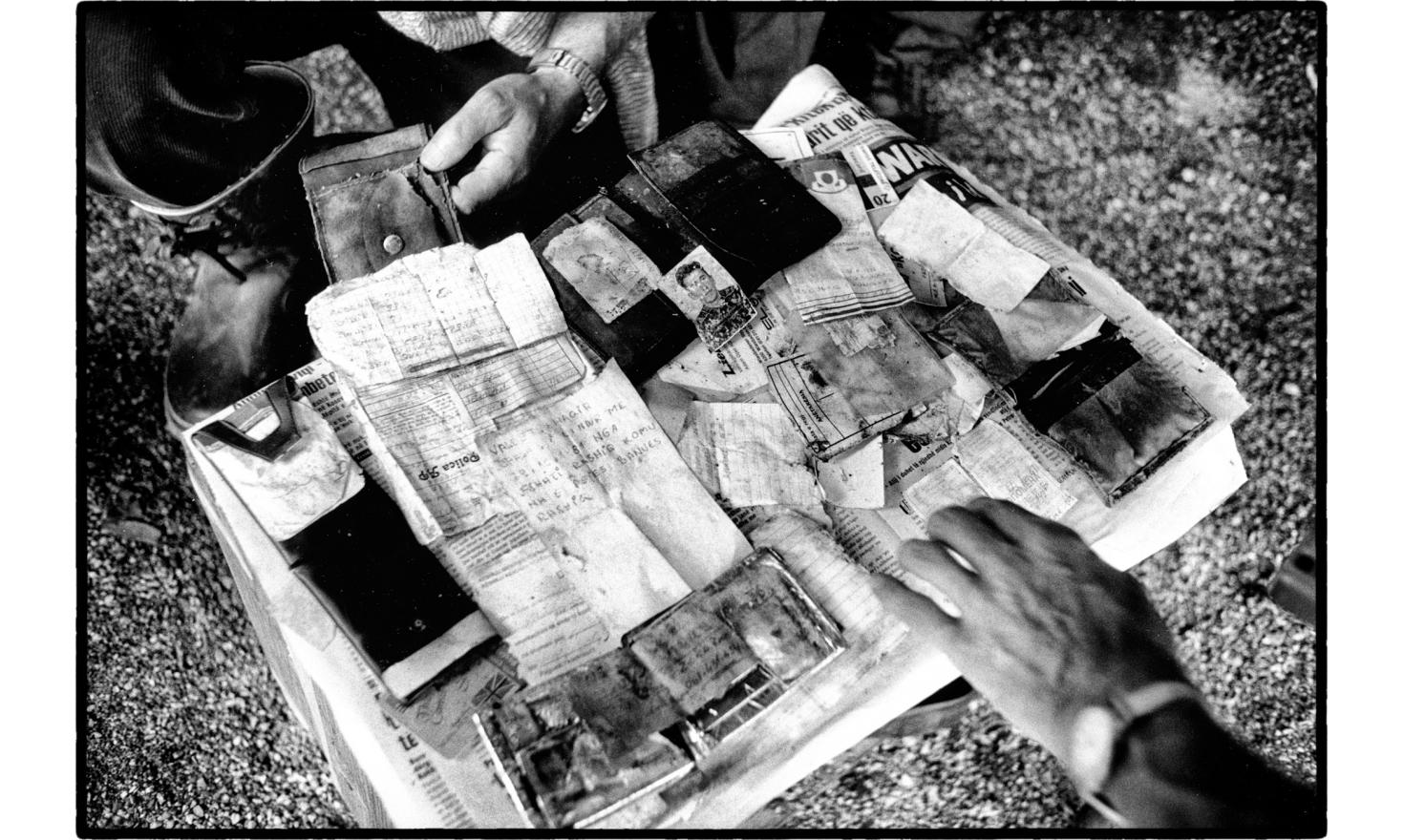collection of personal items of villagers massacred by Serb forces. Lybenic, Kosovo. 07-1999