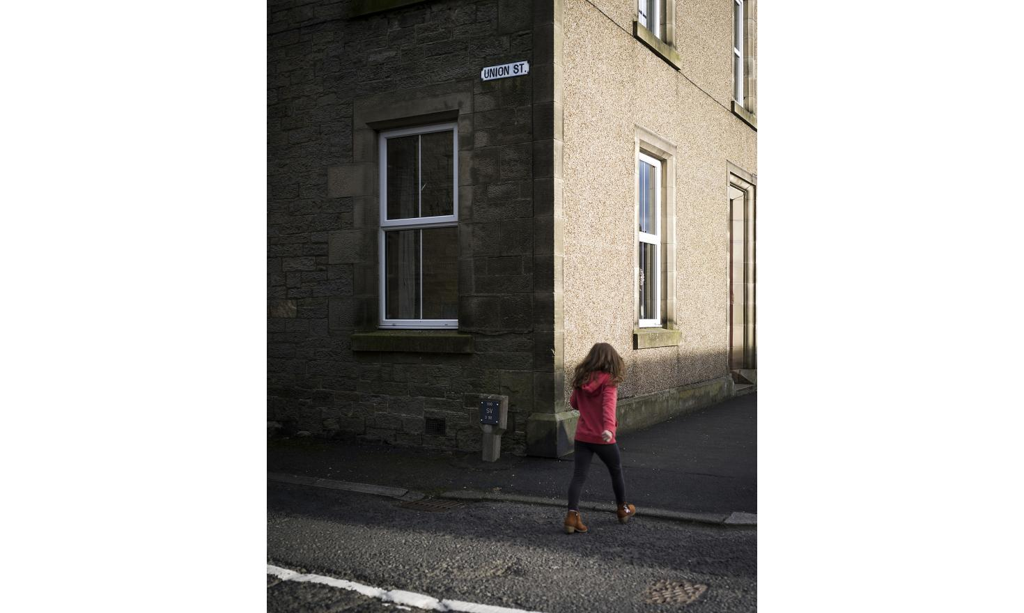 A girl walks past Union Street in the Scottish village of Newcastleton. The Scottish Borders region voted 58,5% for remaining in the EU