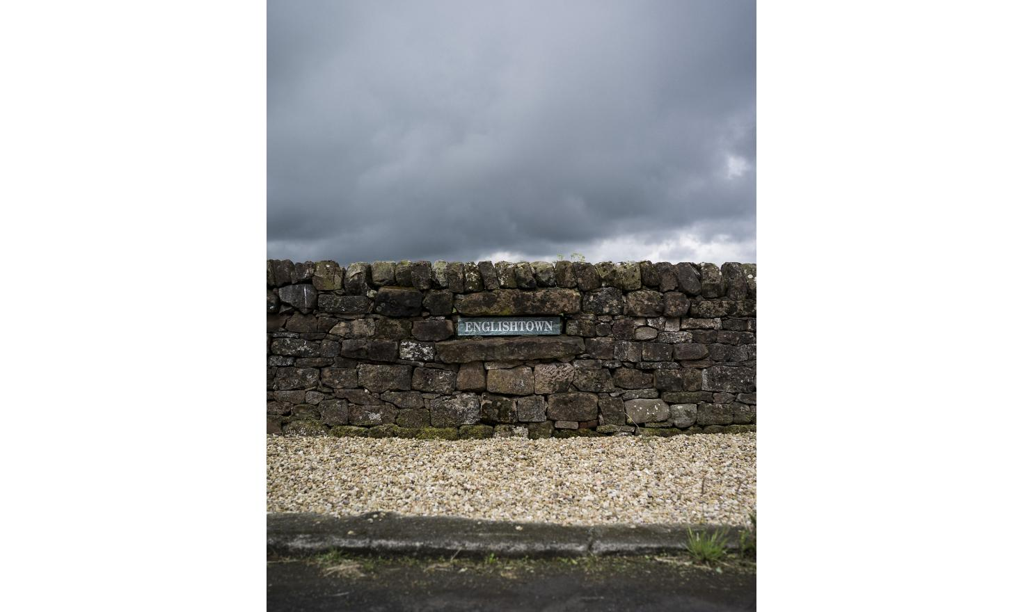 """A sign in a wall on the border between Scotland and England reads """"Englishtown"""". The two countries were divided by the Brexit vote, with Scotland choosing to remain and England choosing to leave"""