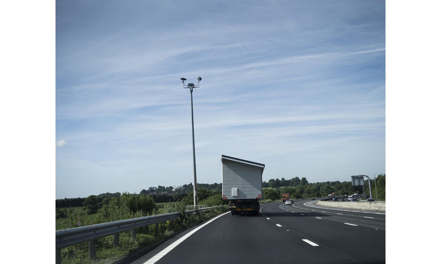 A mobile-home being transported on the motorway in the United Kingdom.