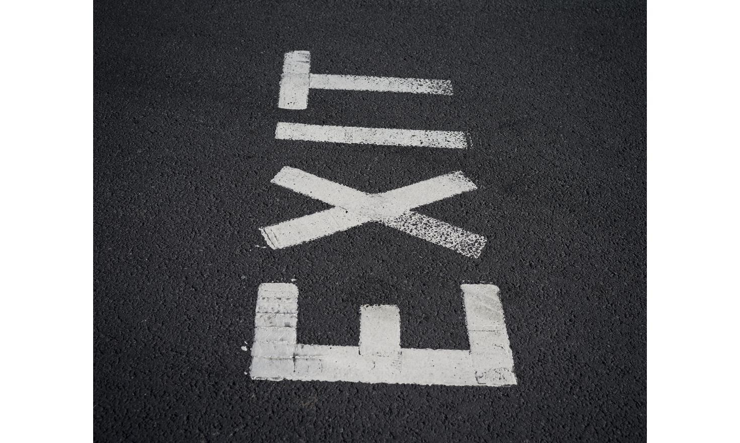 An Exit sign near on a road in the United Kingdom.