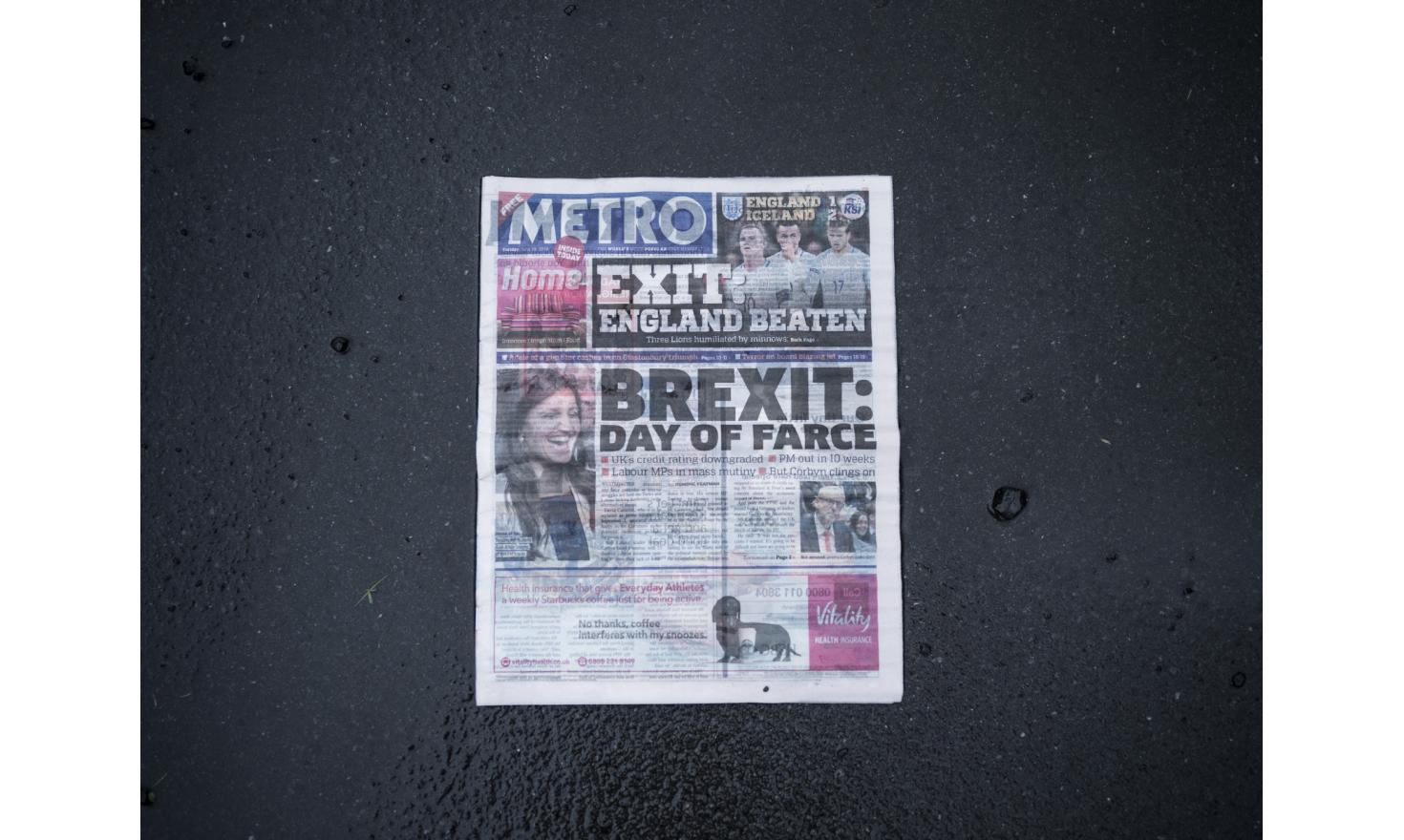 A discarded newspaper with the headline that reads: Brexit: Day of Farce.