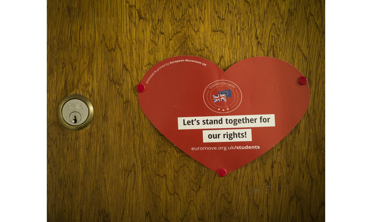 A heart-shaped poster embracing fighting in unity for the rights of British and European people, on the locked door of Claudio Radaelli, Profesor of Political Science at Exeter University.