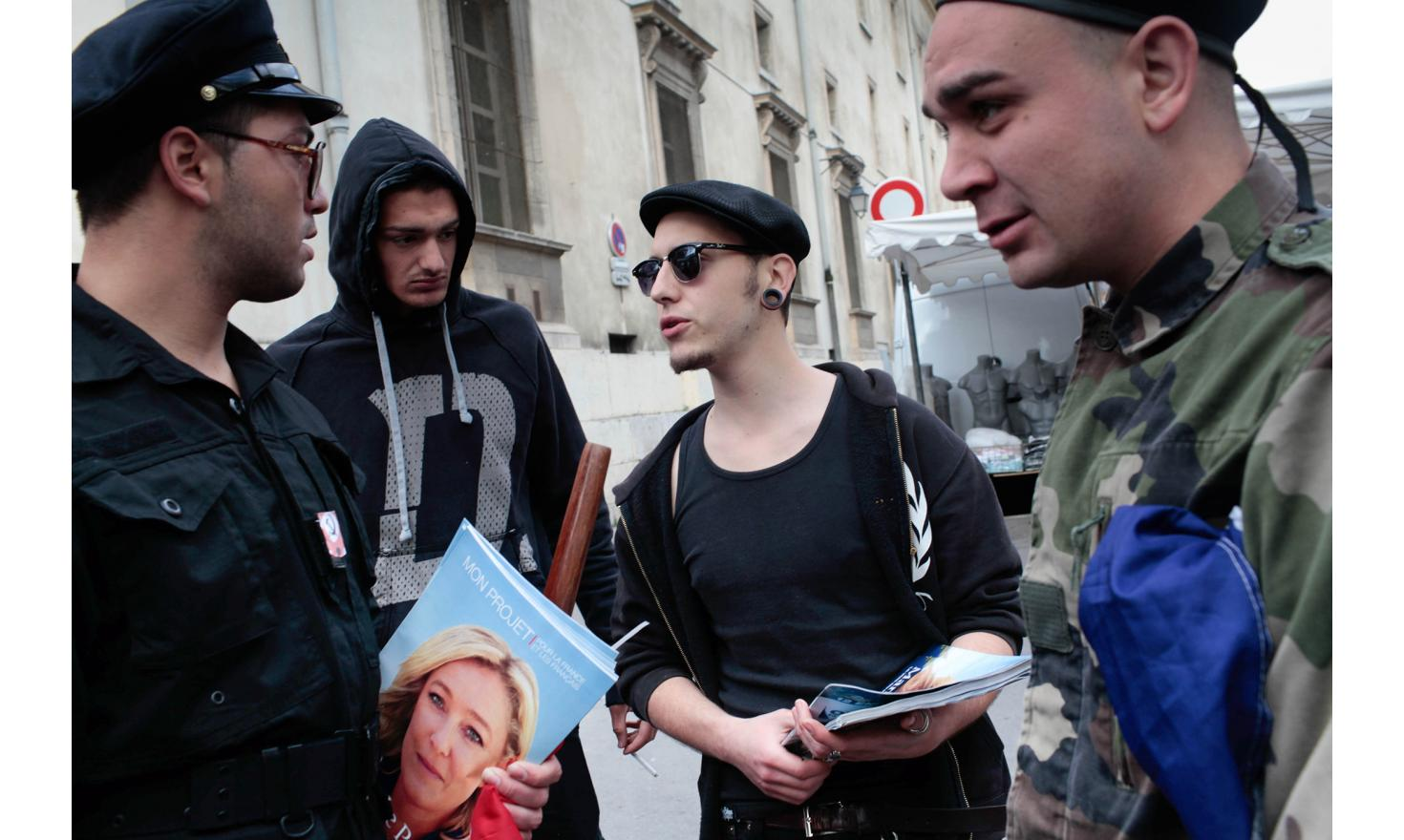 Aix, April 7, 2012. MNBF's (French Nazbol) Activist with FN's flyers.