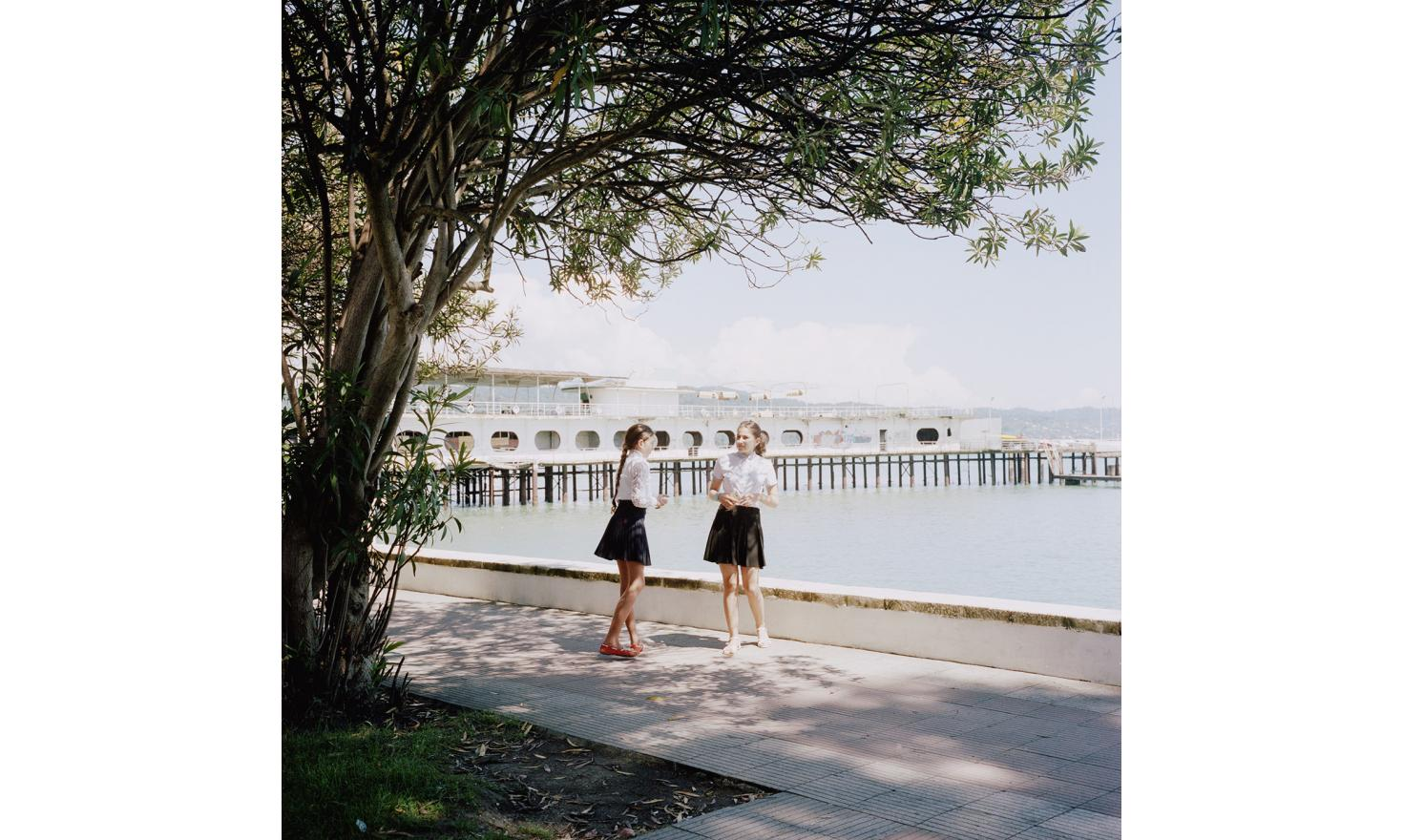 Two young girls along the seaside