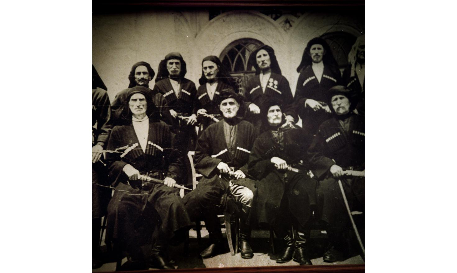 A detail of an old photo of a traditional Abkhaz family