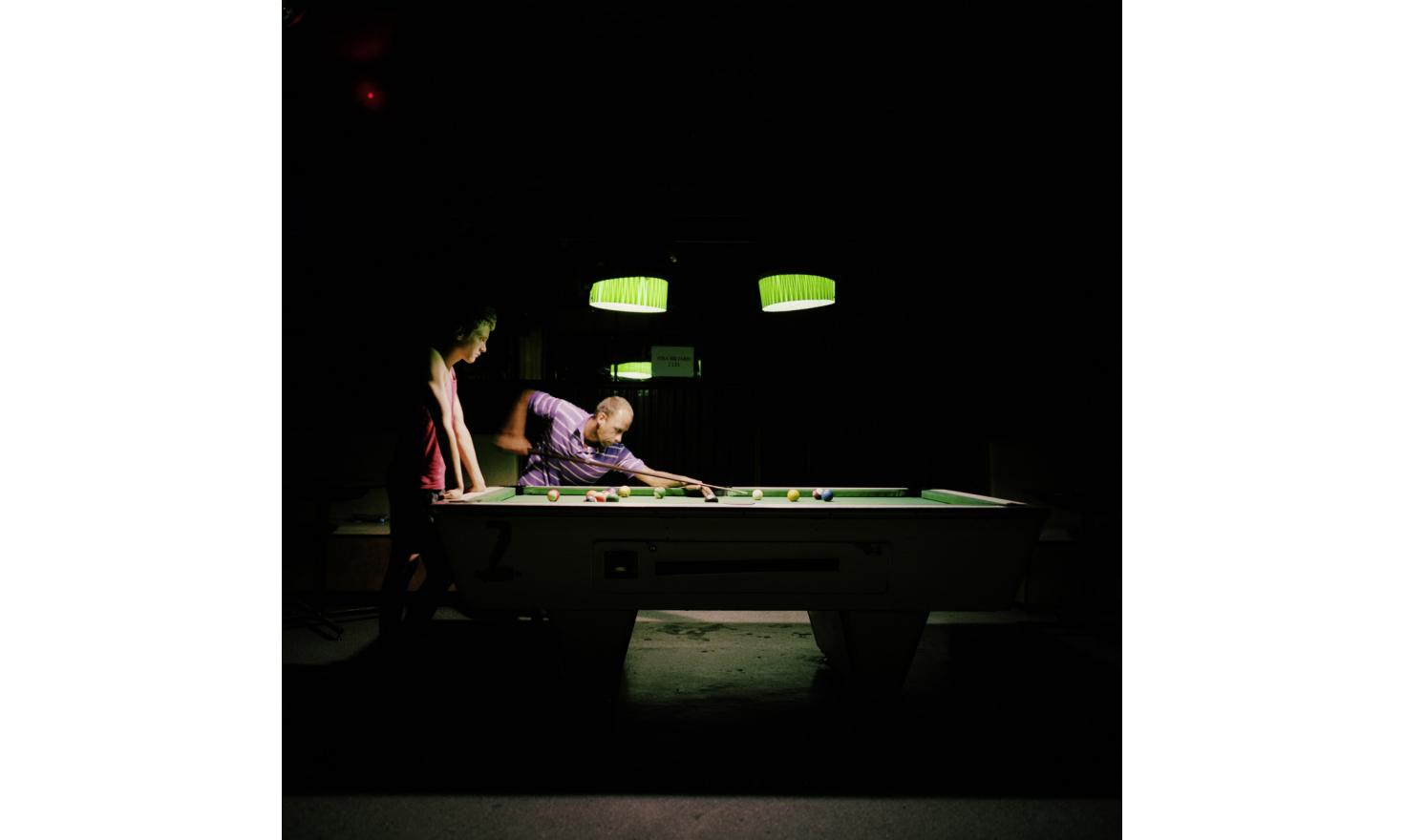 """Young people playing pool in the """"Tip Top"""" bar in Sulina"""