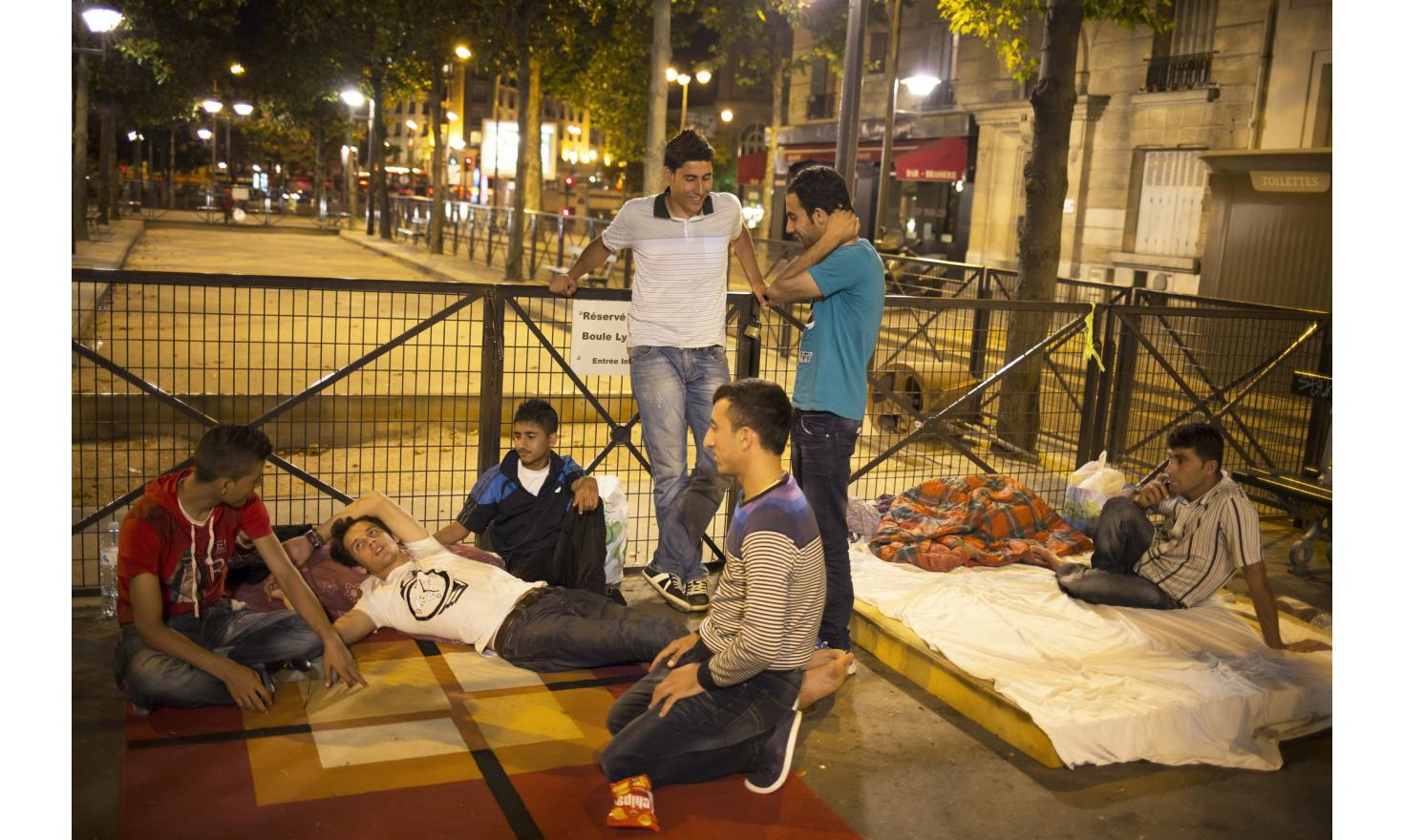 """Paris, France 03/08/2013 Luqman and Fawad in a street near """"Parc Villemin"""" where other Afghan migrants, including lone minors, are sleeping."""