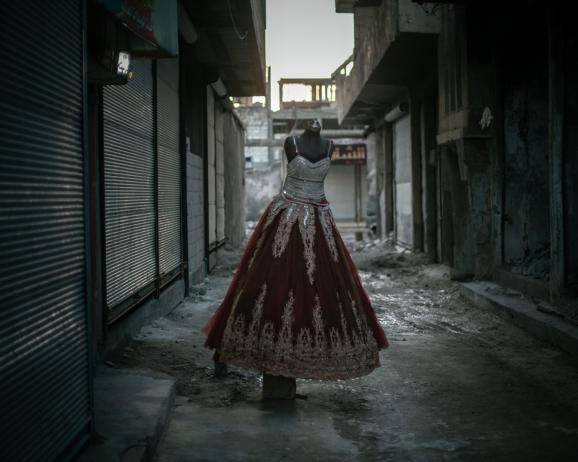 An evening dress in the city of Raqqa. Despite the war and the destruction, life is slowly going back to normal for the resilient inhabitants of the city.