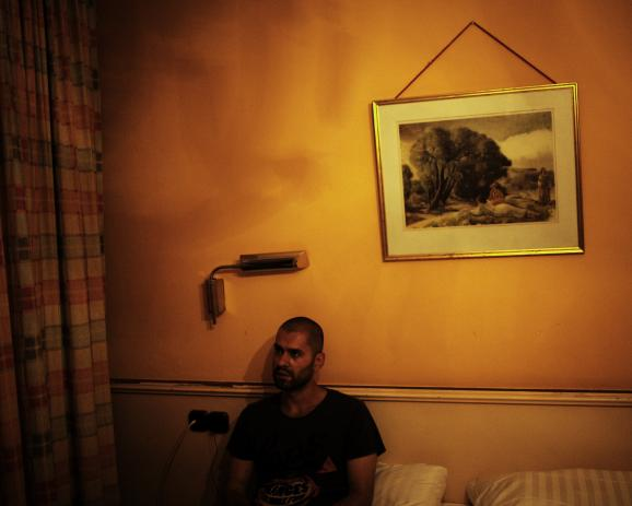 "M. A. Munich, Germany. July 2014 ""If it work, maybe it will be the end of suffering."" M. A. M. A. left Aleppo six month ago, where his parents remain. He is travelling in fear of identity control. In this crappy hotel, the owner don't mind illegal..."